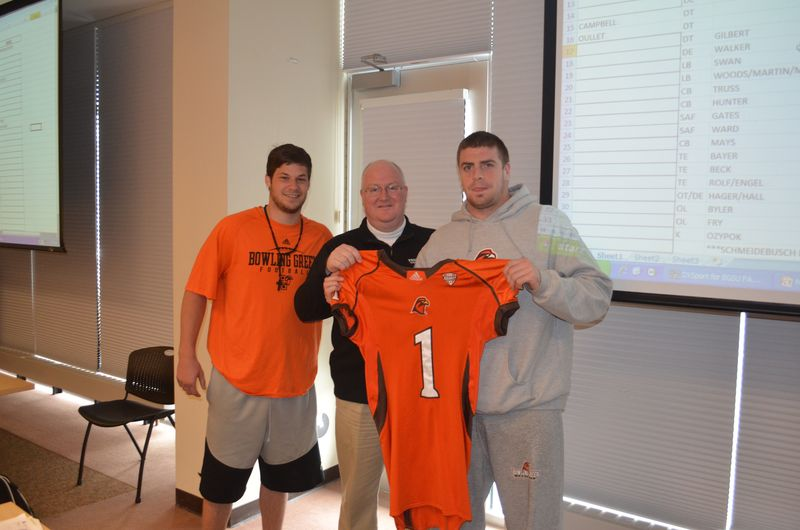 (From left) Matt Schilz, honorary coach John Wagner, Ted Ouellet